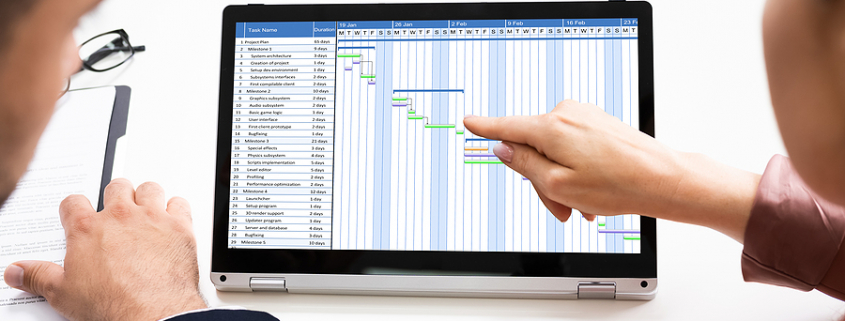 Workers using timesheet software