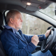 Old man undertaking driving evaluation for seniors