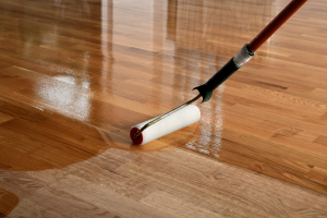 Man lacquering parquetry flooring in Melbourne