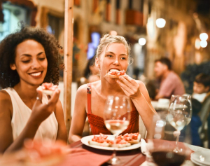 Two woman eating in a restaurant in Leichhardt